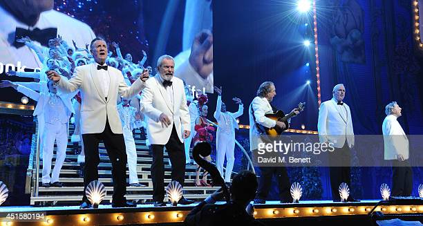 Michael Palin Terry Gilliam and Eric Idle at the opening night of Monty Python Live at The O2 Arena on July 1 2014 in London England