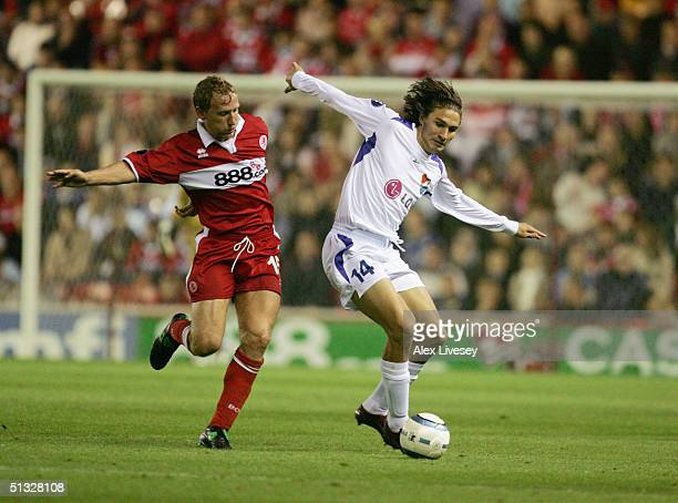 Michael Papadopulos of Banik Ostrava holds off Ray Parlour of Middlesbrough during the UEFA Cup first round, first leg match between Middlesbrough...
