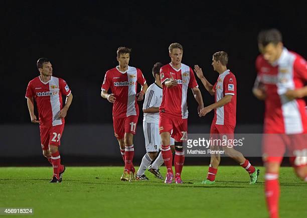 Michael Parensen, Maximilian Thiele, Sebastian Potter and Soeren Brandy of 1.FC Union Berlin celebrate during the friendly match between FC...
