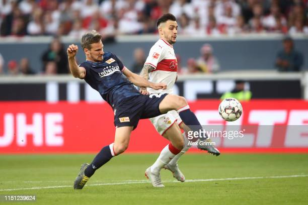 Michael Parensen of 1 FC Union Berlin fights for the ball with Anastasios Donis of VfB Stuttgart during the Bundesliga playoff first leg match...