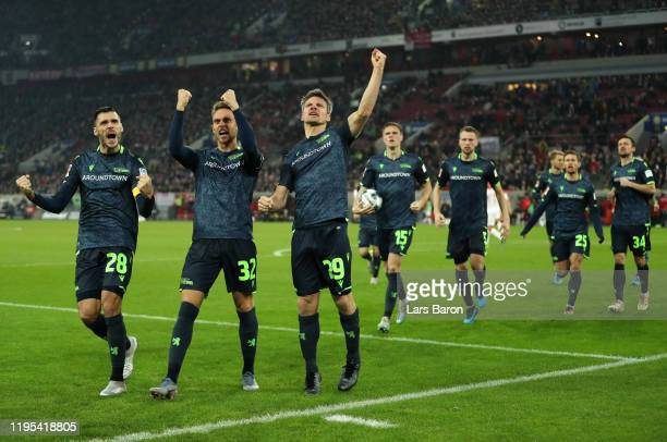 Michael Parensen of Berlin celebrates with team mates after scoring his sides first goal during the Bundesliga match between Fortuna Duesseldorf and...