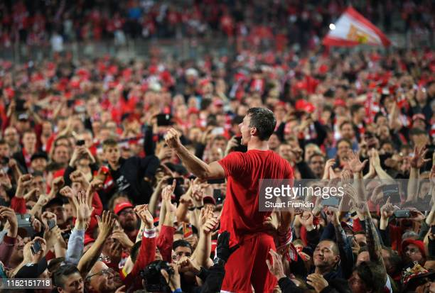 Michael Parensen of Union Berlin celebrates with fans after his team is promoted to the first Bundesliga for the first time in the club's history...