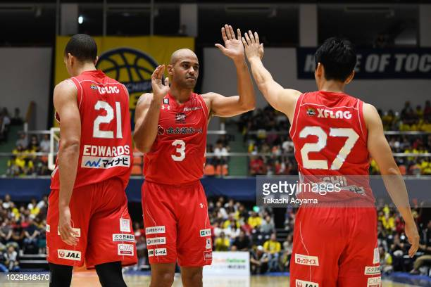 Michael Parker of Chiba Jets high fives with Gavin Edwards and Kosuke Ishii during the B.League Early Cup Kanto 3rd Place Game between Chiba Jets and...