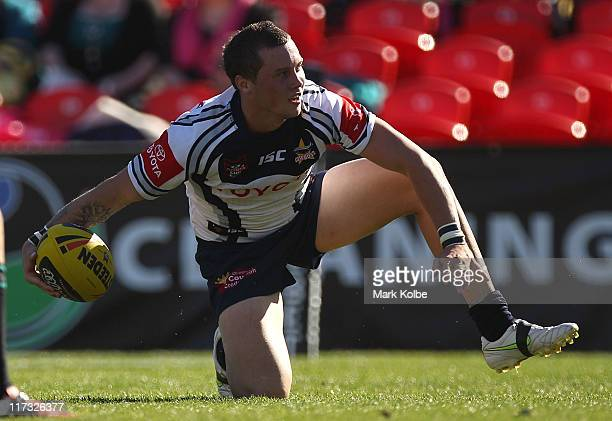 Michael Parker-Walshe of the Cowboys celebrates scoring a try during the round 16 Toyota Cup match between the Penrith Panthers and the North...