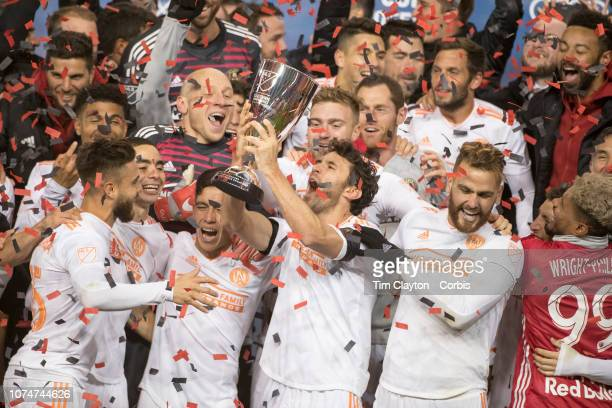 Michael Parkhurst of Atlanta United holds the Eastern Conference trophy aloft as the Atlanta team celebrate their 31 aggregate win during the New...