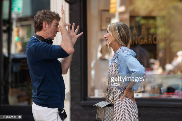 Michael Patrick King and Sarah Jessica Parker are seen filming on July 27, 2021 in New York City, New York.