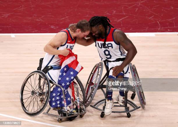 Michael Paye and Matt Scott of Team United States celebrate after defeating Team Japan during the men's Wheelchair Basketball gold medal game on day...
