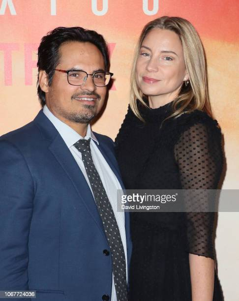 Michael Peña and Brie Shaffer attend Netflix's Narcos Mexico Season 1 Premiere at Regal Cinemas LA Live on November 14 2018 in Los Angeles California