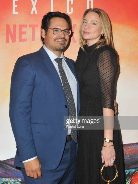 Michael Peña and Brie Shaffer attend Netflix's 'Narcos Mexico' Season 1 Premiere at Regal Cinemas LA Live on November 14 2018 in Los Angeles...