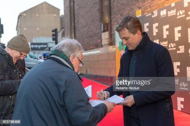 Michael Pearce signs autographs at the UK Premiere of 'Beast' during the 14th Glasgow Film Festival at Glasgow Film Theatre on February 24 2018 in...