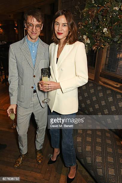 Michael Pegrum and Alexa Chung attend The Fashion Awards in partnership with Swarovski nominees' lunch hosted by the British Fashion Council with...