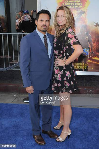 Michael Pena and Brie Shaffer arrive at the Los Angeles Premiere CHiPS at TCL Chinese Theatre on March 20 2017 in Hollywood California