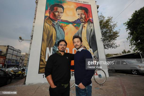 Michael Pena and Diego Luna pose during the photocall to unveil a mural of Netflix Narcos on October 30 2018 in Mexico City Mexico