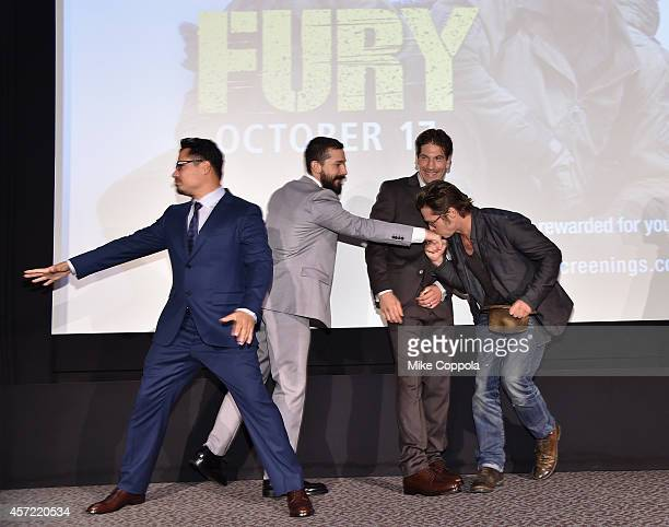Michael Pena Shia LaBeouf Jon Bernthal and Brad Pitt attend the Fury New York premiere at DGA Theater on October 14 2014 in New York City