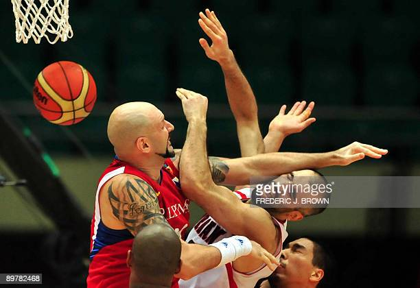 Michael Pennisi of the Philippines plays tough defense on Zaid Abbas of Jordan who attempts to shoot under the basket during their quarterfinal match...