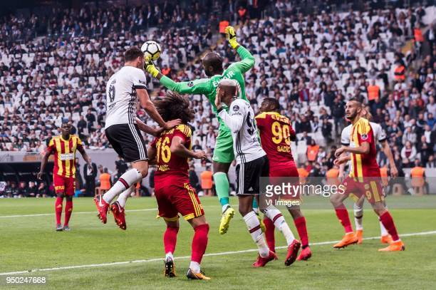 Michael Pereira of Evkur Yeni Malatyaspor Dusko Tosic of Besiktas JK Sadik Çiftpinar of Evkur Yeni Malatyaspor goalkeeper Fabien Farnolle of Evkur...