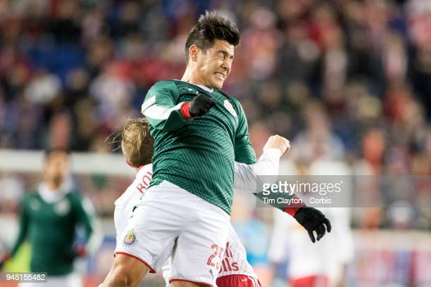 Michael Perez of C.D. Guadalajara is challenged by Daniel Royer of New York Red Bulls during the New York Red Bulls Vs C.D. Guadalajara CONCACAF...
