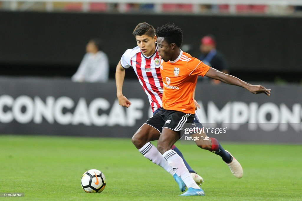 Michael Perez of Chivas fights for the ball with Woodensky Cherenfant of Cibao during the match between Chivas and Cibao as part of the round of 16th of the CONCACAF Champions League at Akron Stadium on February 28, 2018 in Zapopan, Mexico.