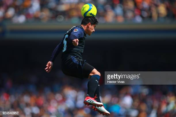Michael Perez of Chivas heads the ball during the 9th round match between Pumas UNAM and Chivas as part of the Torneo Clausura 2018 Liga MX at...
