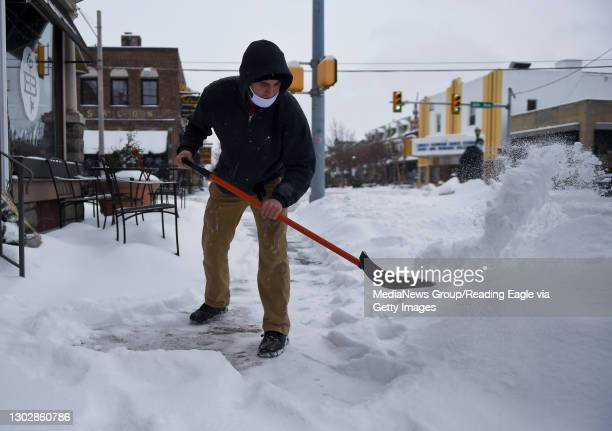 Michael Perez shovels snow in front of Cafe Bold on Penn Ave at the intersection with 6th ave in West Reading. During a snow storm in West Reading,...