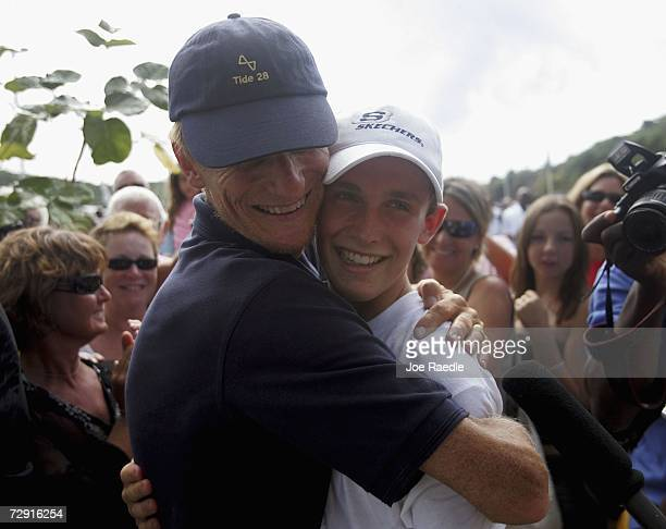 Michael Perham from Potters Bar in Hertfordshire receives a hug from his father Peter Perham after they arrive in Antigua on January 03 2007 in...