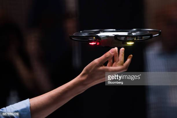 Michael Perry director of strategic partnerships at SZ DJI Technology Co pilots the Spark gesture controlled drone during the company's launch event...
