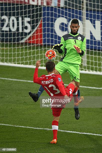 Michael Petrasso of Canada chips the ball past goalie Sandy Sanchez of Cuba for a goal to take a 1-0 lead in the 25th minute during the 2015 CONCACAF...
