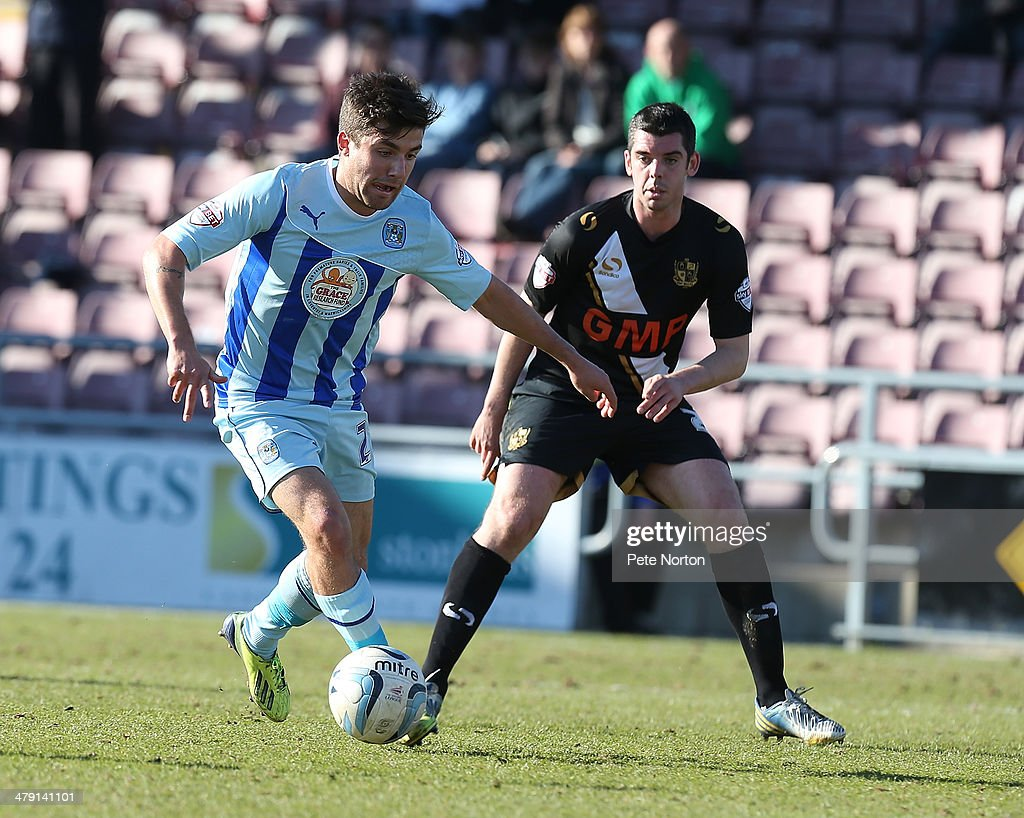Michael Petrasso of Coventry City controls the ball watched by Richard Duffy of Port Vale during the Sky Bet League One match between Coventry City and Port Vale at Sixfields Stadium on March 16, 2014 in Northampton, England.