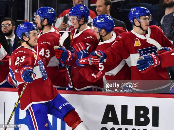 Michael Pezzetta of the Laval Rocket celebrates a shootout goal with teammates on the bench against the Providence Bruins during the AHL game at...