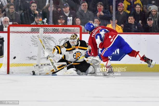 Michael Pezzetta of the Laval Rocket scores a shootout goal on goaltender Zane McIntyre of the Providence Bruins during the AHL game at Place Bell on...