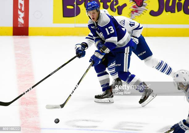 Michael Pezzetta of the Sudbury Wolves controls the puck against Nicolas Hague of the Mississauga Steelheads during CHL game action on October 6 2017...