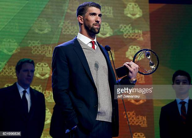 Michael Phelps accepts his Golden Goggles award for the 2016 Male Race of the Year at the 2016 Golden Goggles Awards at the Marriott Marquis Hotel on...