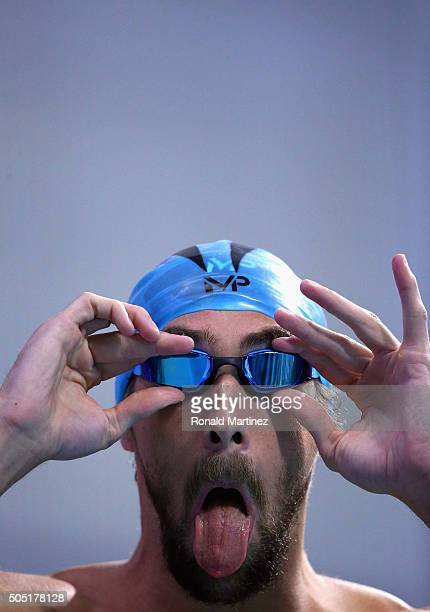 Michael Phelps adjusts his googles before competing in the Men's 100 meter butterfly final during the Arena Pro Swim Series at Austin on January 15...