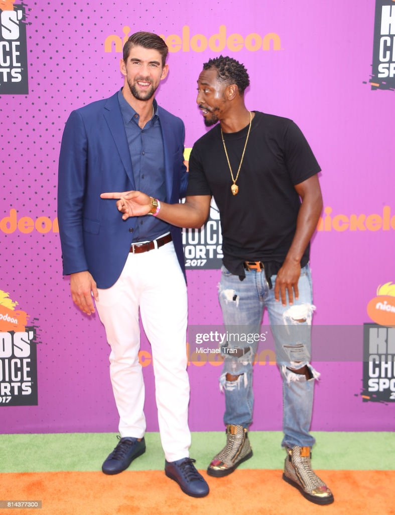 Michael Phelps (L) and Darris Love arrive at Nickelodeon Kids' Choice Sports Awards 2017 held at Pauley Pavilion on July 13, 2017 in Los Angeles, California.