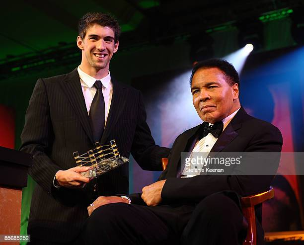 Michael Phelps and Muhammad Ali pose during Muhammad Ali's Celebrity Fight Night XV held at the JW Marriott Desert Ridge Resort Spa on March 28 2009...