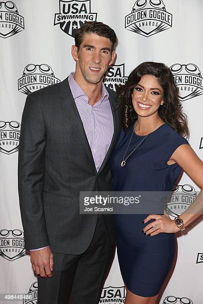 Michael Phelps and Nicole Johnson attend the 2015 USA Swimming Golden Goggle Awards at JW Marriot at LA Live on November 22 2015 in Los Angeles...