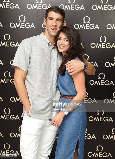 Michael Phelps and Nicole Johnson pictured at Swimming Legends night at OMEGA House Rio 2016 on August 15 2016 in Rio de Janeiro Brazil