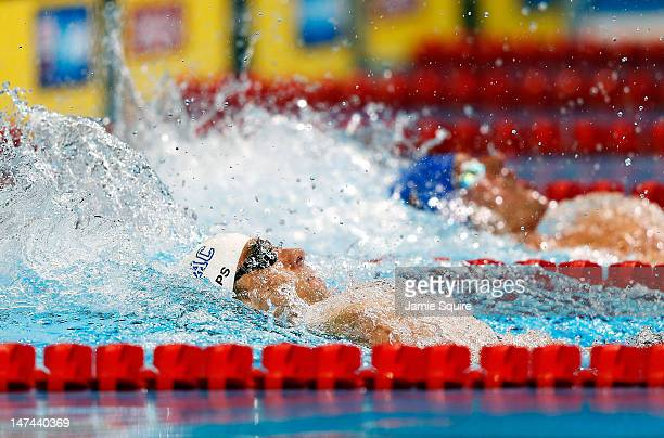 Michael Phelps and Ryan Lochte compete in the first semifinal heat of the Men's 200 m Individual Medley during Day Five of the 2012 US Olympic...