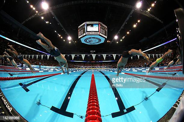 Michael Phelps and Ryan Lochte dive of the starting block at the start of the championship final of the Men's 200 m Individual Medley during Day Six...