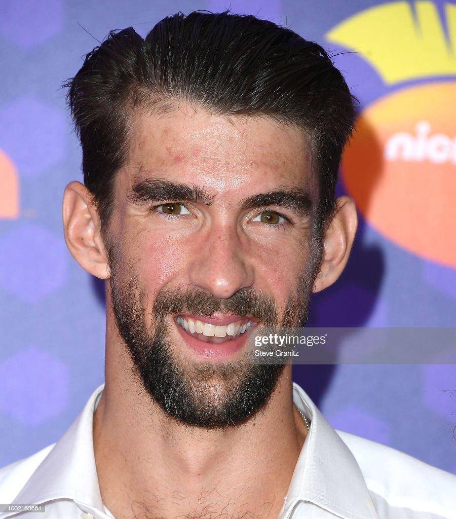 Michael Phelps, arrives at the Nickelodeon Kids' Choice Sports Awards 2018 at Barker Hangar on July 19, 2018 in Santa Monica, California.