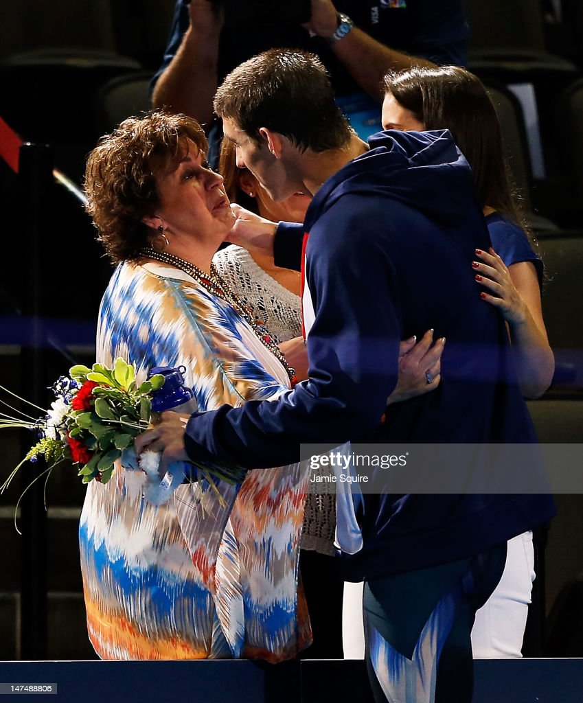 Michael Phelps celebrates with his mom Debbie after the medal ceremony for the Men's 200 m Individual Medley during Day Six of the 2012 U.S. Olympic Swimming Team Trials at CenturyLink Center on June 30, 2012 in Omaha, Nebraska.