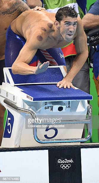 Michael Phelps cheers teammate Nathan Adrian as he swims the last leg of the 4X100meter freestyle relay on Sunday Aug 7 2016 at the Rio Games The...
