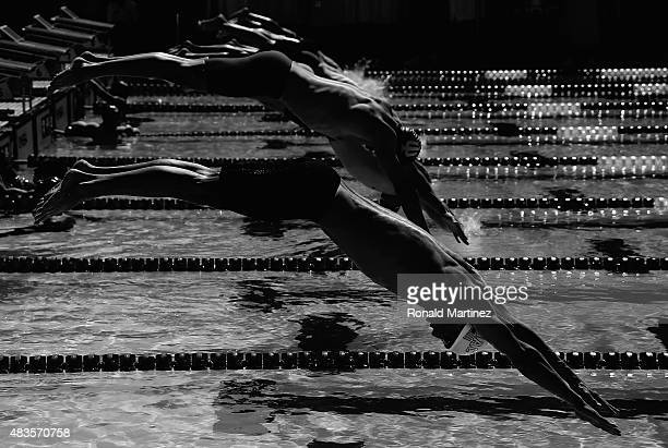 Michael Phelps dives in to start the Men's 200 LC Meter Breaststroke during the 2015 Phillips 66 National Championships at the Northside Swim Center...