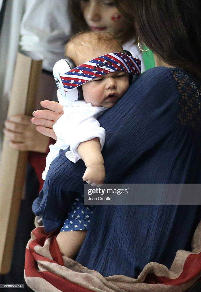 Michael Phelps' fiancee Nicole Johnson, holds their son Boomer Phelps on day 6 of the Rio 2016 Olympic Games at Olympic Aquatics Stadium on August 11, 2016 in Rio de Janeiro, Brazil.