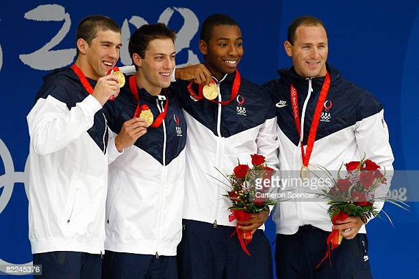 Michael Phelps, Garrett Weber-Gale, Cullen Jones, Jason Lezak of the United States pose with the gold medal during the medal ceremony for the Men's 4...