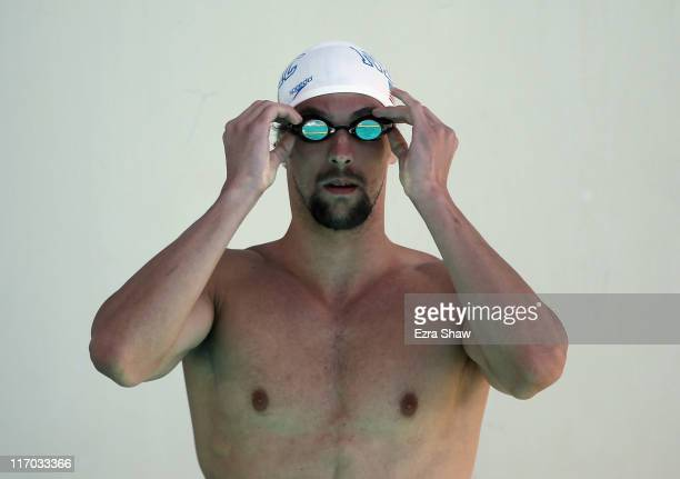 Michael Phelps gets ready for a race by the practice pool during day 4 of the Santa Clara International Grand Prix at George F Haines International...