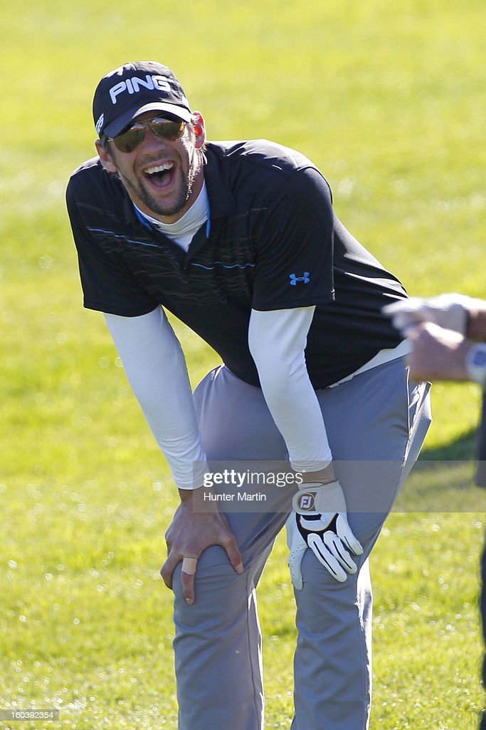 Michael Phelps laughs on the 18th green during the Wednesday Pro-Am of the Waste Management Phoenix Open at TPC Scottsdale on January 30, 2013 in Scottsdale, Arizona.