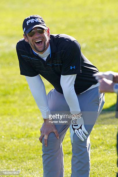 Michael Phelps laughs on the 18th green during the Wednesday ProAm of the Waste Management Phoenix Open at TPC Scottsdale on January 30 2013 in...
