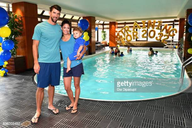 Michael Phelps Nicole Phelps and Boomer Phelps attendthe Huggies Little Swimmers #trainingfor2032 Swim Class With The Phelps Foundation on August 21...