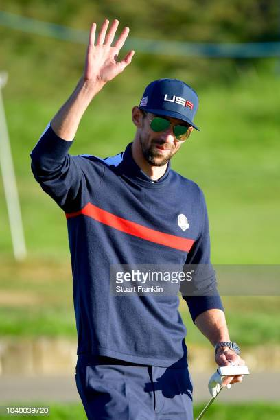 Michael Phelps of Team USA acknowledges the crowd during the celebrity challenge match ahead of the 2018 Ryder Cup at Le Golf National on September...
